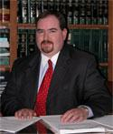 Chris Moore of Leonard & Moore Legal Services